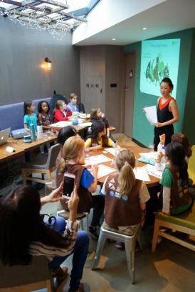 Lucy Luo presents to the Girl Scouts on the different food groups